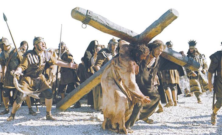 quem ajudou jesus a carregar a cruz